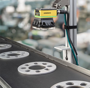 Cognex in-sight 2000 mounted above metal discs on conveyor for default inspection
