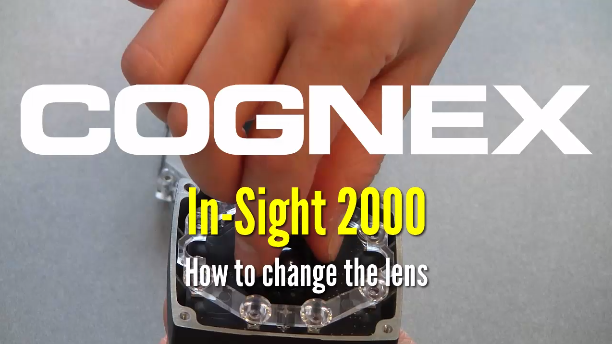 person demonstrates changing lens on in-sight 2000