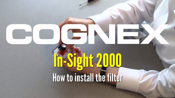person installing filter on in-sight 2000