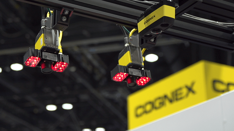 cognex cameras mounted in a booth in a convention setting